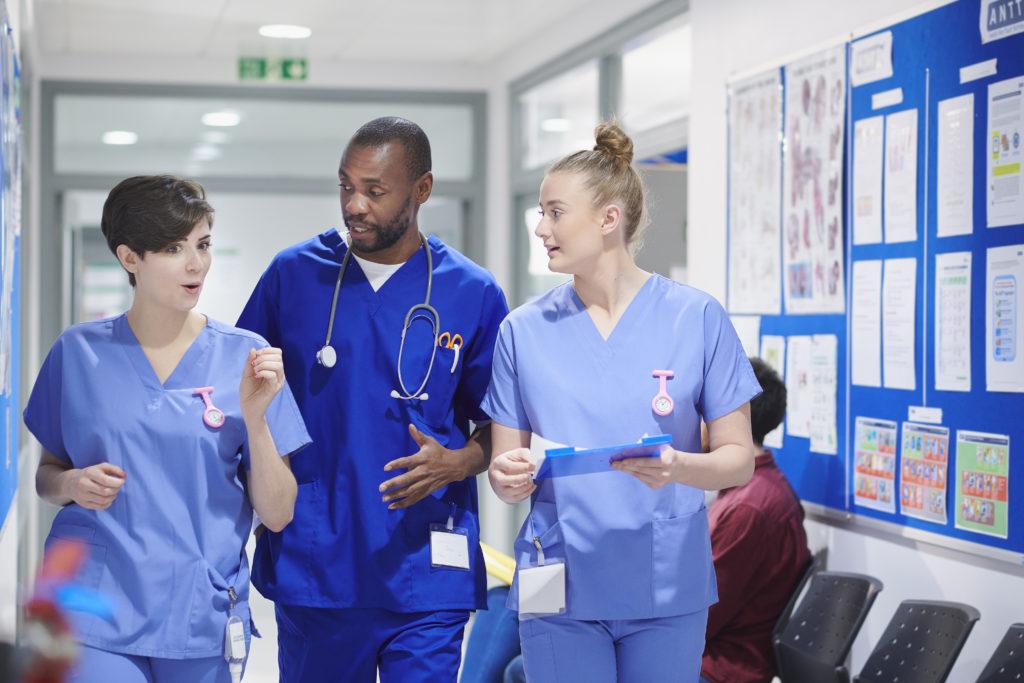 NHS staff in corridor